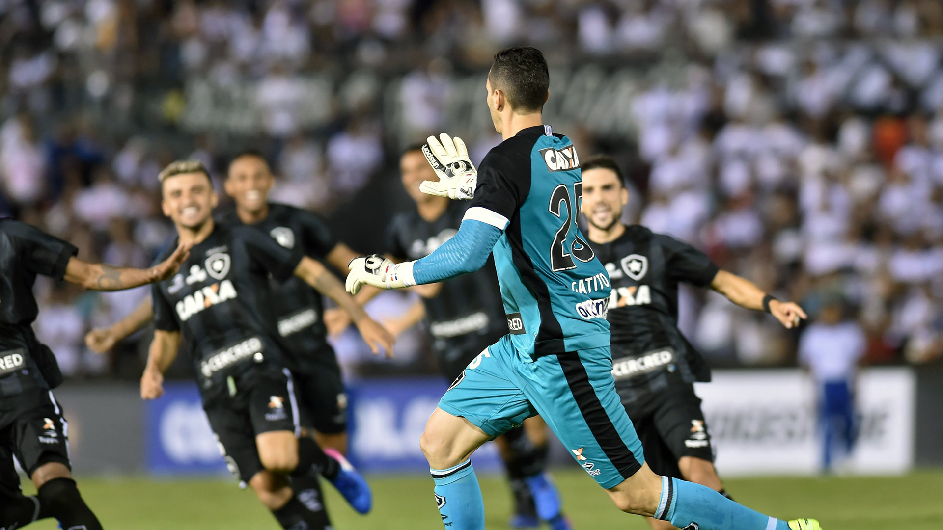 Brazil's Botafogo player Gatito Fernandez (C) celebrates with teammates after blocking three penalty shots by Paraguay's Olimpia during their Copa Libertadores 2017 football match at the Defensores del Chaco stadium in Asuncion, Paraguay, on February 22, 2017. / AFP / NORBERTO DUARTE        (Photo credit should read NORBERTO DUARTE/AFP/Getty Images)